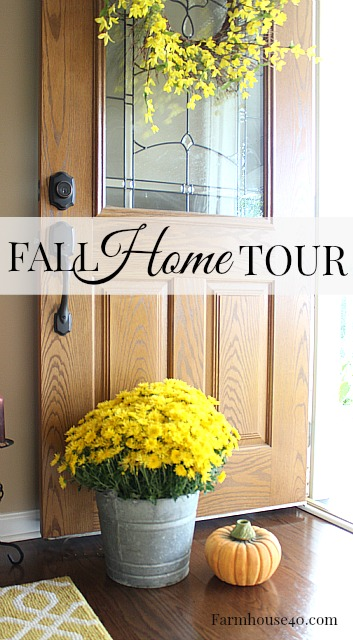 front door with yellow mum and yellow wreath