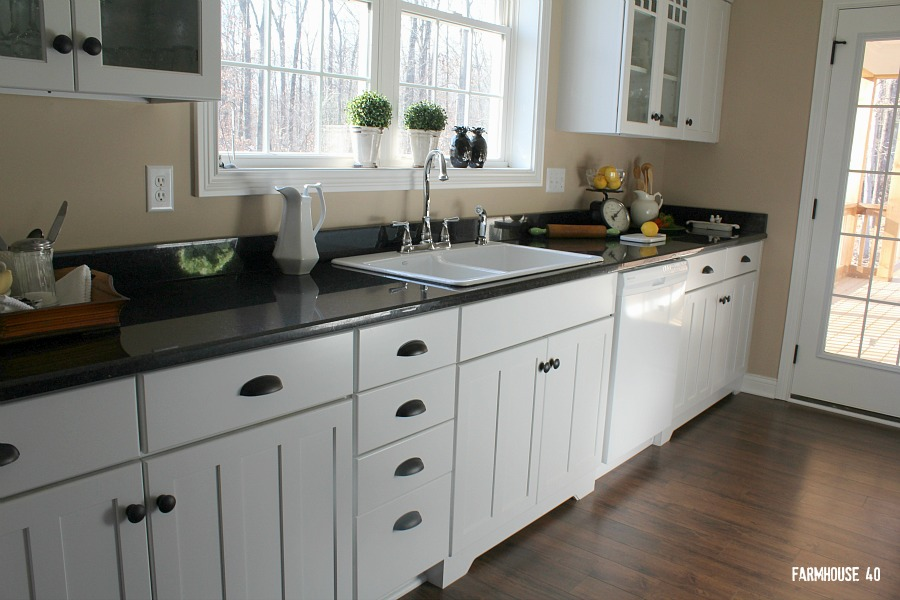 white kitchen cabinets in the farmhouse