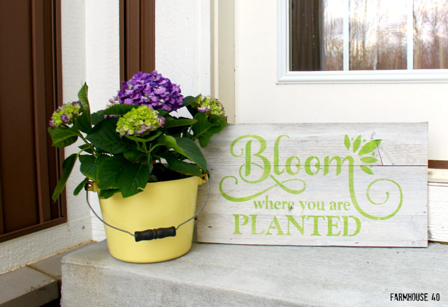 wood bloom stenciled sign