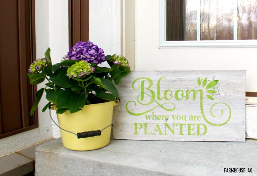 wood bloom stenciled sign