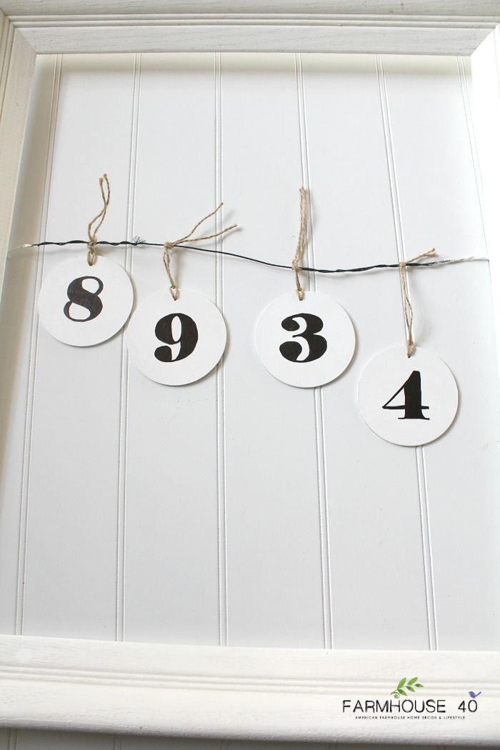 white frame hanging number tags